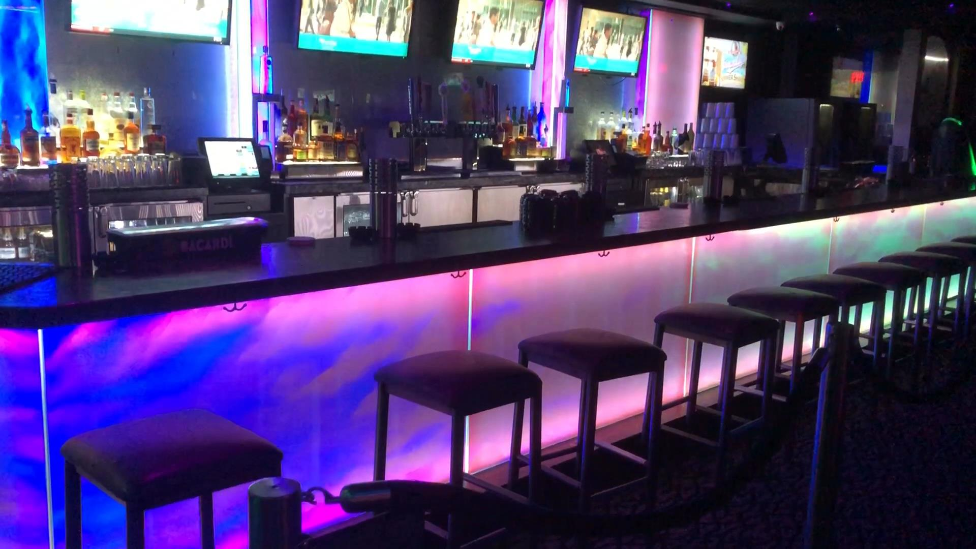Photo of LED backlit bar with architectural glass