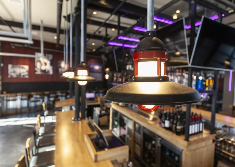 Photo depicting architectural pendant lighting and LED lighting for liquor bottle displays