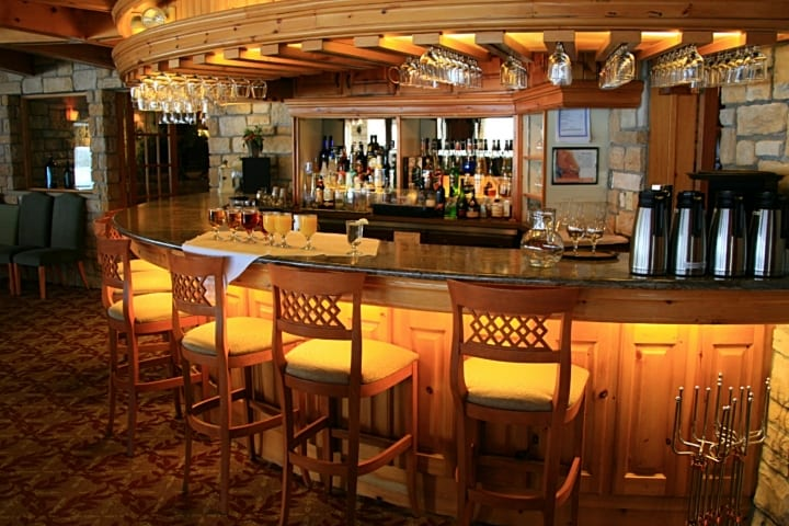 Photo of curved commercial bar with wood finishes