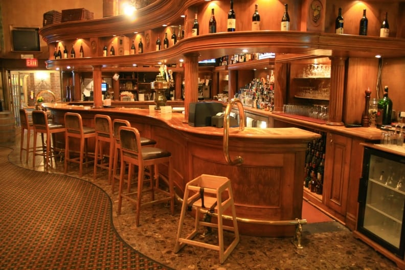 Photo of bar with curved foot rail