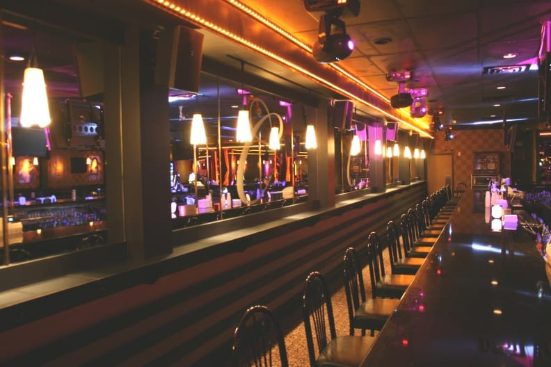Photo of a wall-supported drink rail at a night club