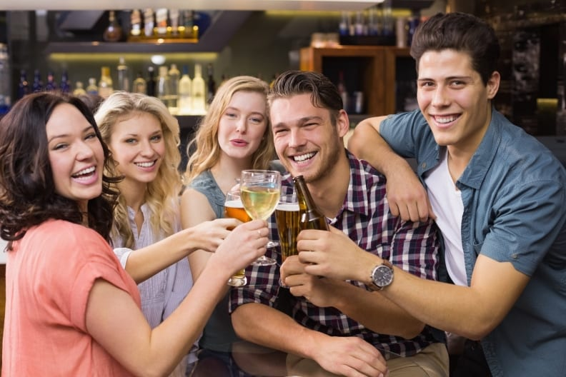 Photo of happy bar customers sharing a drink