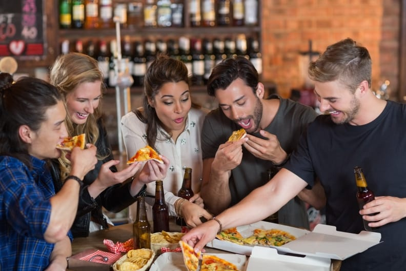 Group of people enjoying dinner at a pizza restaurant
