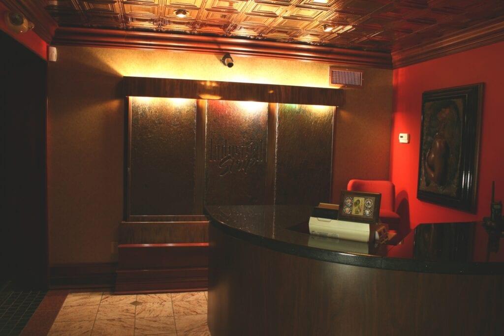Photo of nightclub lobby desk with a granite countertop