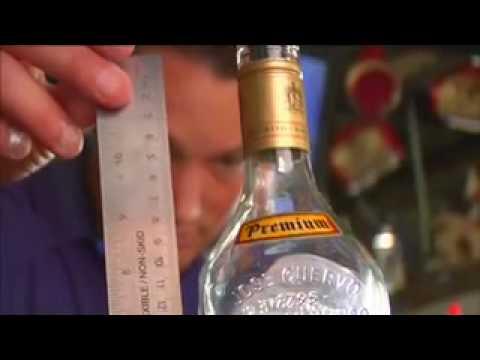 Photo of liquor bottle volume being measured