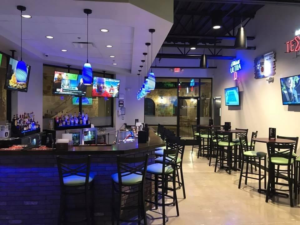 Bar designed by Cabaret Design Group for X-Golf San Antonio