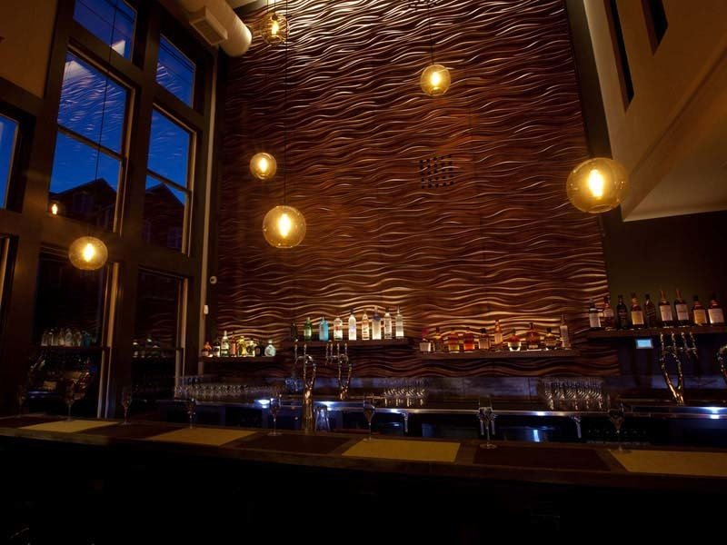 Photo of sculpted wood wall panel for bar design
