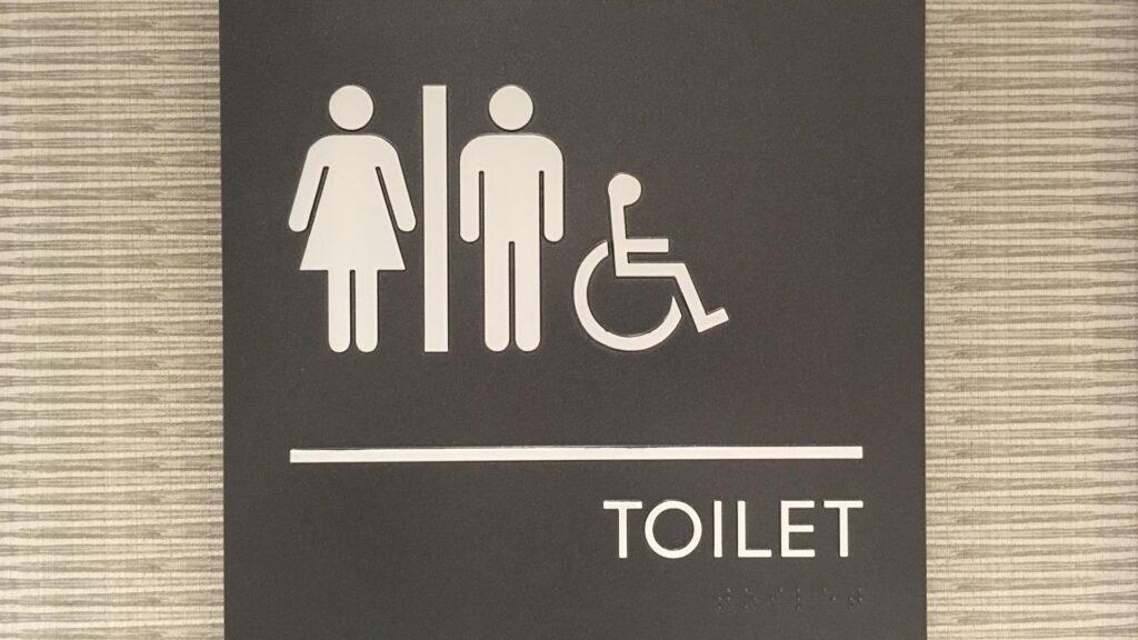 Photo of ADA restroom sign