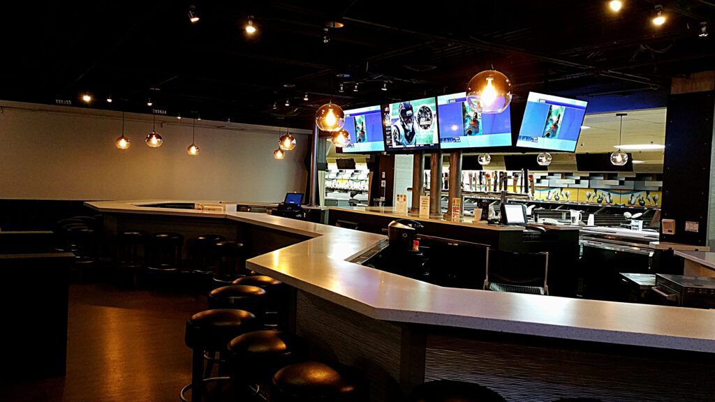 Photo of large island bar and back bar after redesign