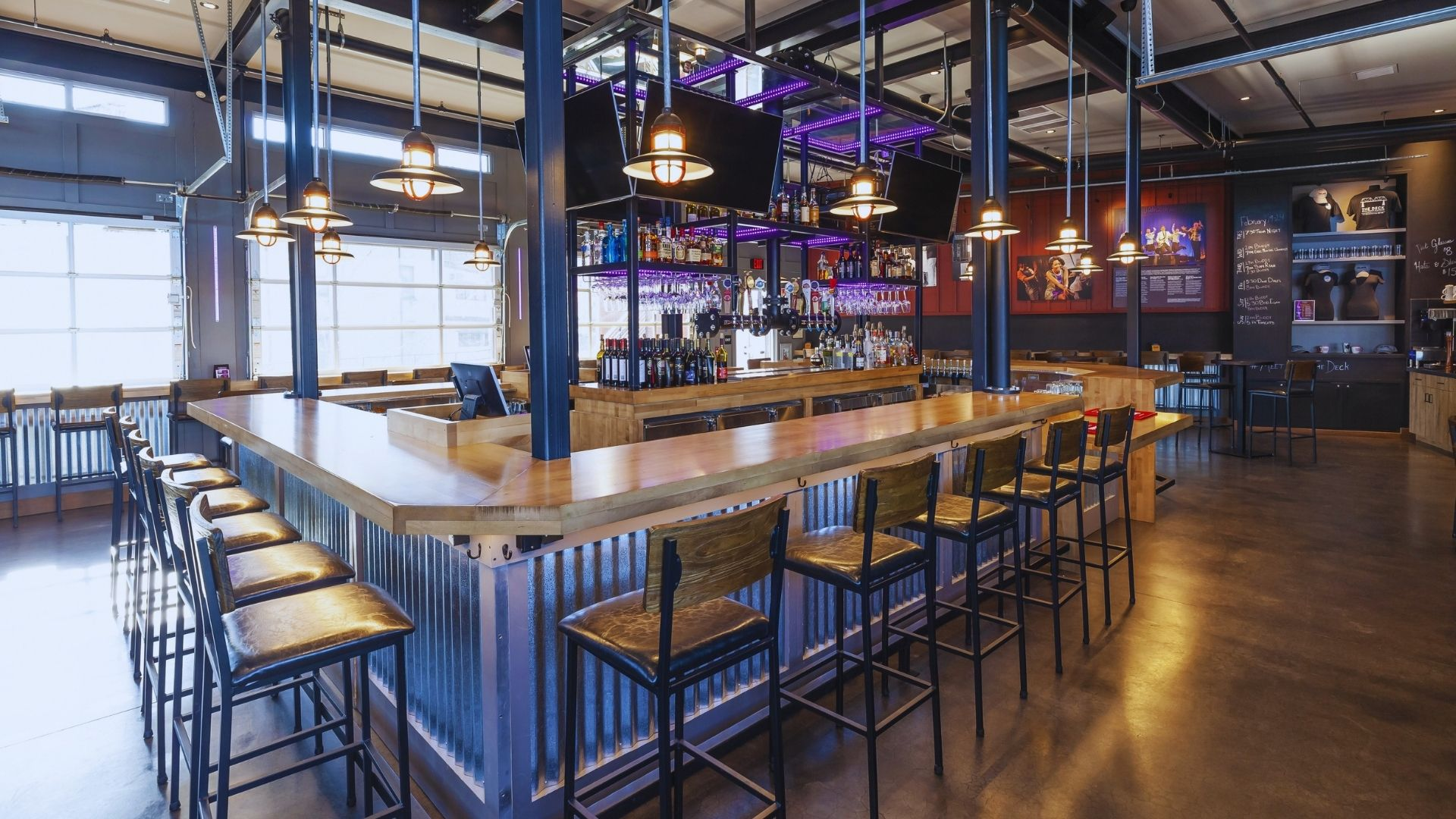 Photo of bar with square steel foot rail